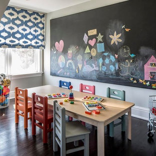 Example of a mid-sized transitional gender-neutral dark wood floor kids' room design in New York with white walls