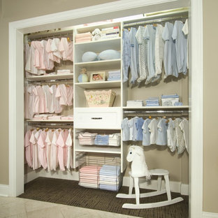 Photo of a medium sized shabby-chic style gender neutral toddler's room in Other with beige walls and carpet.