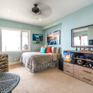 Transitional carpeted kids' room photo in Hawaii with blue walls