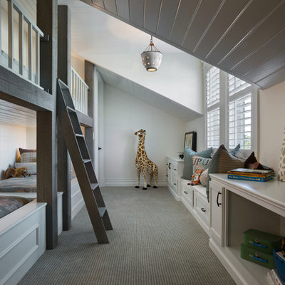 Inspiration for a mid-sized timeless gender-neutral carpeted kids' room remodel in Orlando with white walls