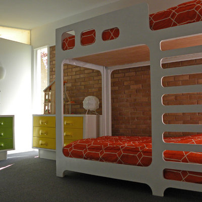 Kids' room - 1950s gender-neutral carpeted and red floor kids' room idea in Dallas with white walls
