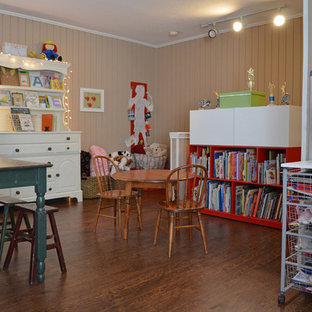 This is an example of a traditional gender-neutral kids' room for kids 4-10 years old in Dallas with beige walls and medium hardwood floors.