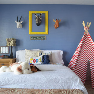 Example of a classic boy carpeted kids' room design in Dallas with blue walls