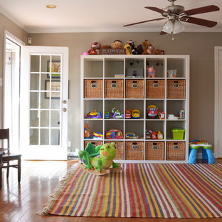 Example of a classic gender-neutral medium tone wood floor kids' room design in Dallas with beige walls