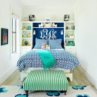 Kids' bedroom - coastal girl light wood floor kids' bedroom idea in Charleston with white walls