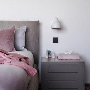 На фото: огромная детская в современном стиле с белыми стенами, паркетным полом среднего тона, бежевым полом, кессонным потолком, спальным местом и деревянными стенами для подростка, девочки с