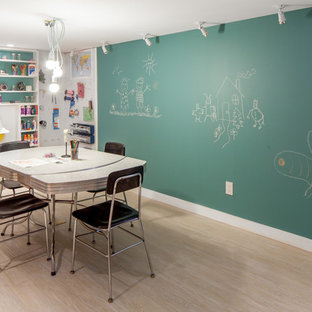 Example of a trendy gender-neutral playroom design in Toronto with multicolored walls