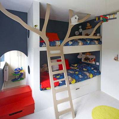 Kids' room - contemporary gender-neutral white floor kids' room idea in Dublin with blue walls