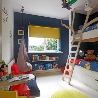 Inspiration for a contemporary gender-neutral white floor kids' bedroom remodel in Dublin with multicolored walls