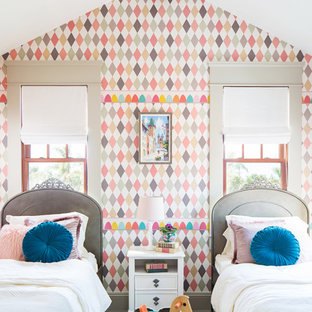 Example of an eclectic carpeted and gray floor kids' room design in San Diego with multicolored walls