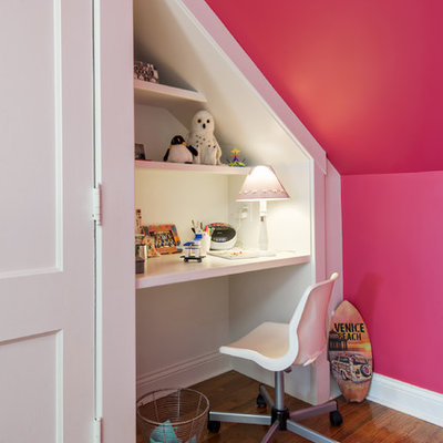 Transitional girl medium tone wood floor kids' study room photo in Louisville with pink walls