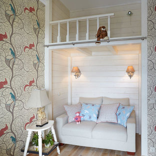Inspiration for a mid-sized traditional kids' bedroom for kids 4-10 years old and girls in Moscow with multi-coloured walls and light hardwood floors.