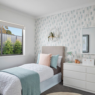Photo of a contemporary kids' bedroom for girls in Melbourne with multi-coloured walls, concrete floors and grey floor.