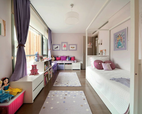Example Of A Trendy Girl Kidsu0027 Bedroom Design In Other With Pink Walls