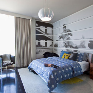 Example of a trendy boy dark wood floor kids' room design in Miami with gray walls