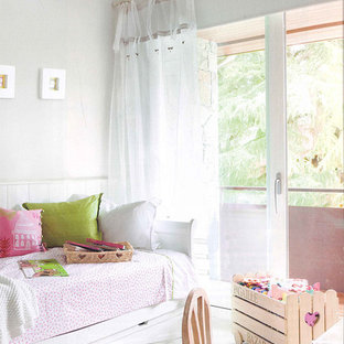 Inspiration for a small shabby-chic style girl painted wood floor kids' room remodel in Madrid with white walls