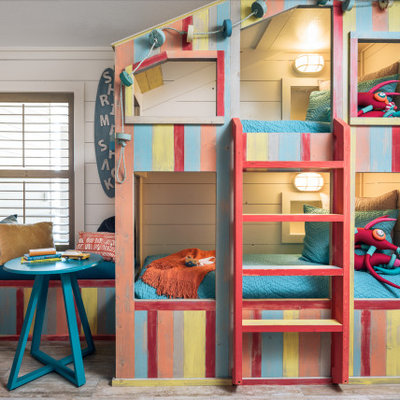 Mid-sized beach style gender-neutral ceramic tile and beige floor kids' room photo in Other with white walls