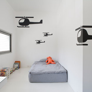 Inspiration for a mid-sized modern gender-neutral kids' bedroom in Other with white walls, white floor and painted wood floors.