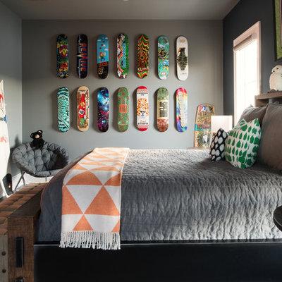 Example of a trendy gender-neutral dark wood floor and brown floor kids' room design in Orlando with gray walls