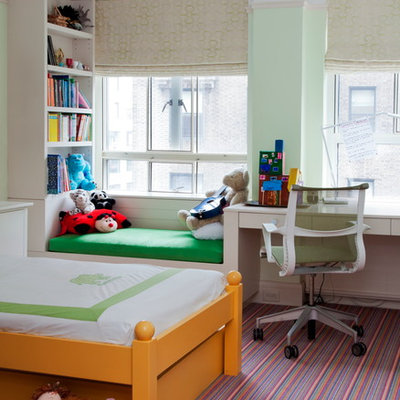 Example of a small transitional girl carpeted kids' room design in New York with green walls