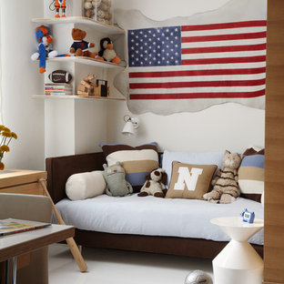 Trendy boy kids' bedroom photo in New York with beige walls