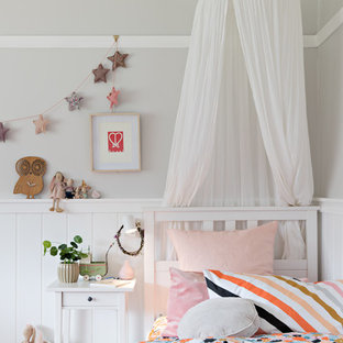 Inspiration for a traditional kids' room for girls in Wollongong with grey walls and medium hardwood floors.