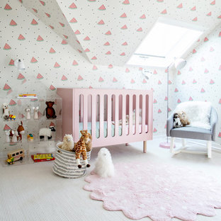 Mid-sized eclectic girl carpeted and beige floor kids' room photo in New York with multicolored walls