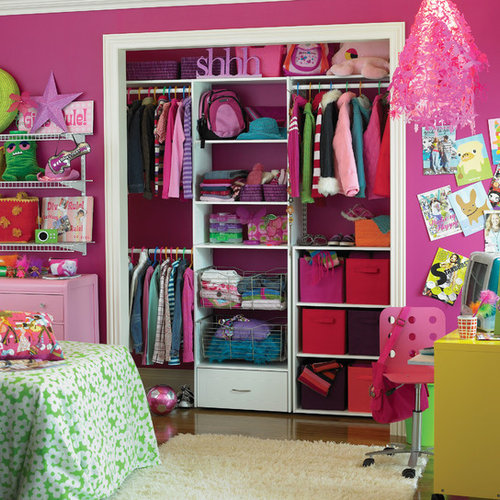 Inspiration for an eclectic girl kids room remodel in other with pink walls