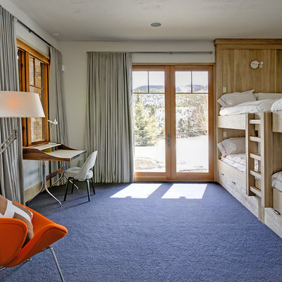 Example of an eclectic gender-neutral carpeted and blue floor kids' room design in New York
