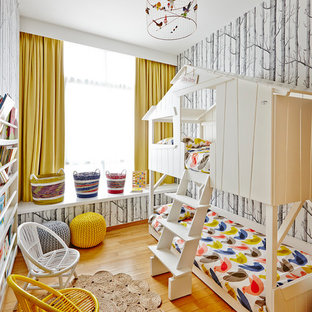 Design ideas for an eclectic gender-neutral kids' room in Singapore with light hardwood floors.