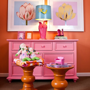 Photo of an eclectic kids' bedroom for girls in Nashville with orange walls and carpet.
