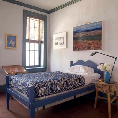 Example of an eclectic gender-neutral carpeted kids' room design in New York with white walls