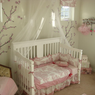 Example of an eclectic girl carpeted kids' bedroom design in Other with white walls