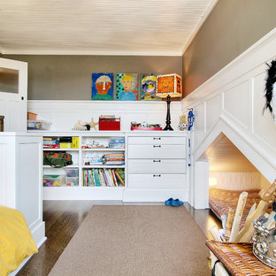 This is an example of a bohemian gender neutral kids' room in Seattle with grey walls, dark hardwood flooring and brown floors.