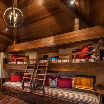 Kids' bedroom - rustic dark wood floor kids' bedroom idea in Sacramento with beige walls