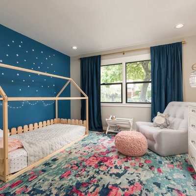 Kids' room - mid-sized transitional girl medium tone wood floor kids' room idea in San Francisco with multicolored walls