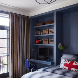 Example of a transitional light wood floor and beige floor kids' bedroom design in Chicago with blue walls
