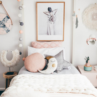 This is an example of a mid-sized contemporary kids' room for kids 4-10 years old in Melbourne with white walls.