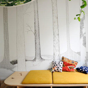 Photo of a contemporary gender-neutral toddler room in Melbourne with light hardwood floors.