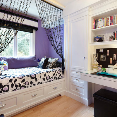 Kids' room - mid-sized traditional girl light wood floor kids' room idea in Toronto with multicolored walls