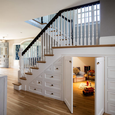Example of a cottage medium tone wood floor and brown floor playroom design in Providence