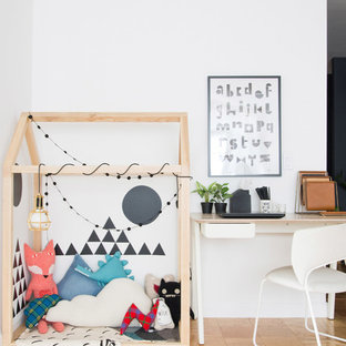 Playroom - scandinavian gender-neutral plywood floor and brown floor playroom idea in Other with white walls