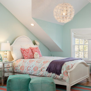 Example of a transitional girl kids' room design in Boston with blue walls
