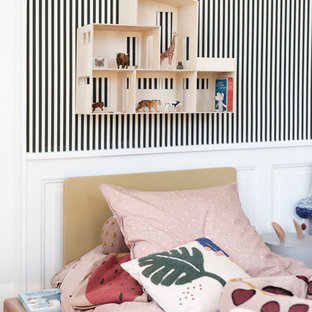 Inspiration for a scandinavian kids' bedroom in Melbourne with white walls, medium hardwood floors and brown floor.