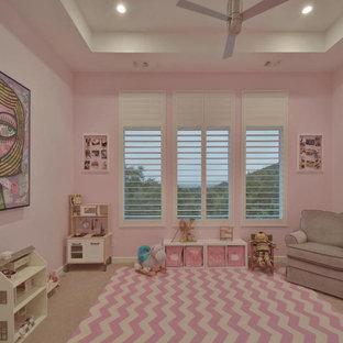 На фото: большая детская в современном стиле с спальным местом, розовыми стенами, ковровым покрытием, бежевым полом и кессонным потолком для ребенка от 1 до 3 лет, девочки