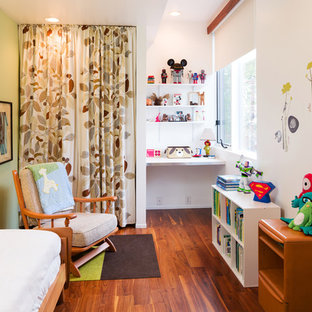 Example of a trendy boy dark wood floor kids' bedroom design in Atlanta with white walls