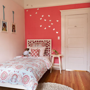 Transitional kids' room photo in San Francisco with pink walls
