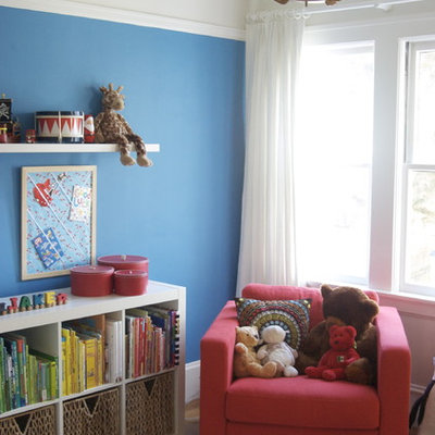 Trendy kids' room photo in San Francisco with multicolored walls