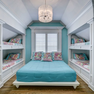 Example of a mid-sized classic girl brown floor and dark wood floor kids' room design in Nashville with blue walls