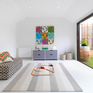 Contemporary gender-neutral kids' playroom in Melbourne with white walls and white floor.